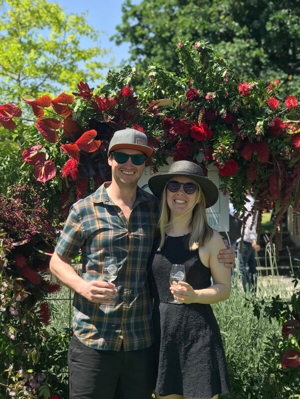 bryce-and-naomi-standing-in-front-of-the-floral-arbour