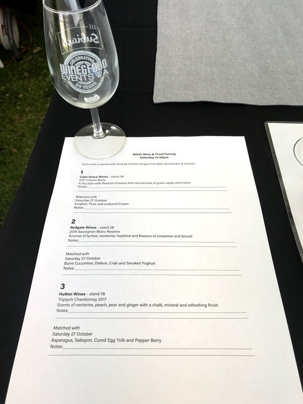 white-paper-with-list-of-wines-and-food