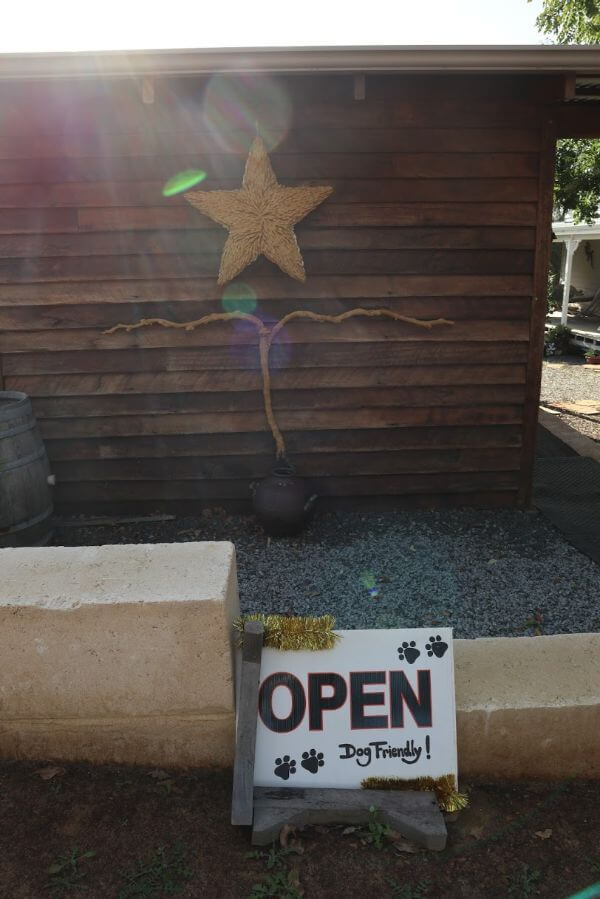 open and dog friendly sign with a star on the wooden wall at rising star wines on scotsdale road denmark wine region